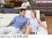 Купить «Man and woman are selecting of new sofa», фото № 32938209, снято 19 июня 2017 г. (c) Яков Филимонов / Фотобанк Лори