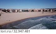 Купить «Aerial view of small Mediterranean coastal town of Torredembarra in Catalonia, Spain», видеоролик № 32947481, снято 18 марта 2019 г. (c) Яков Филимонов / Фотобанк Лори