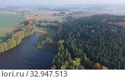 Купить «Impressive autumn landscape of trees and river», видеоролик № 32947513, снято 15 октября 2019 г. (c) Яков Филимонов / Фотобанк Лори