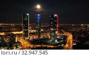 Купить «Night view of the four towers (Cuatro Torres) of the business district in Madrid. Spain», видеоролик № 32947545, снято 14 июля 2020 г. (c) Яков Филимонов / Фотобанк Лори