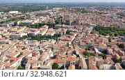 Купить «Scenic panoramic aerial view of residential areas of Narbonne with medieval Roman Catholic Cathedral on sunny summer day, France», видеоролик № 32948621, снято 30 августа 2019 г. (c) Яков Филимонов / Фотобанк Лори