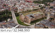 Купить «Aerial view of ancient Templar castle in small Spanish city of Ponferrada on background of modern cityscape», видеоролик № 32948993, снято 19 июня 2019 г. (c) Яков Филимонов / Фотобанк Лори