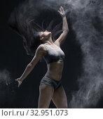 Woman jumping gracefully in dust cloud view. Стоковое фото, фотограф Гурьянов Андрей / Фотобанк Лори
