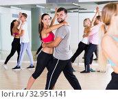 Купить «Positive young couples enjoying of partner dance», фото № 32951141, снято 9 октября 2017 г. (c) Яков Филимонов / Фотобанк Лори