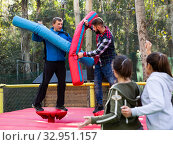Купить «Male friends fighting by big stuffed beams», фото № 32951157, снято 6 августа 2020 г. (c) Яков Филимонов / Фотобанк Лори