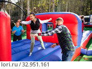 Купить «Friends having fun passing obstacle course», фото № 32951161, снято 10 июля 2020 г. (c) Яков Филимонов / Фотобанк Лори