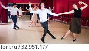 Laughing people dancing lindy hop in pairs. Стоковое фото, фотограф Яков Филимонов / Фотобанк Лори