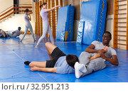 Купить «Two men practicing self defense techniques», фото № 32951213, снято 31 октября 2018 г. (c) Яков Филимонов / Фотобанк Лори