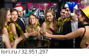 Купить «Happy females and males celebrating new year», фото № 32951297, снято 20 апреля 2017 г. (c) Яков Филимонов / Фотобанк Лори