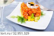 Купить «Cube of fresh tartar with salmon, trout, avocado and greens on plate», фото № 32951329, снято 21 февраля 2020 г. (c) Яков Филимонов / Фотобанк Лори