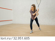 Female player with squash racket in action. Стоковое фото, фотограф Tryapitsyn Sergiy / Фотобанк Лори