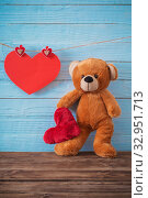 Купить «Teddy bear with red heart on old wooden background. Valentine's», фото № 32951713, снято 14 декабря 2019 г. (c) Майя Крученкова / Фотобанк Лори