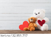Купить «Teddy bear with red heart on old wooden background. Valentine's», фото № 32951717, снято 14 декабря 2019 г. (c) Майя Крученкова / Фотобанк Лори