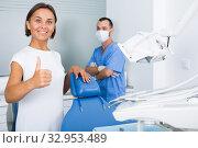Купить «Female is satisfied after treatment in dental clinic», фото № 32953489, снято 10 июля 2017 г. (c) Яков Филимонов / Фотобанк Лори