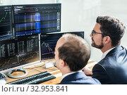 Купить «Stock brokers looking at computer screens, trading online.», фото № 32953841, снято 10 января 2020 г. (c) Matej Kastelic / Фотобанк Лори