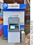 Купить «Doha, Qatar - Nov 18. 2019. ATM of QIB Bank in Doha City Center», фото № 32954173, снято 18 ноября 2019 г. (c) Володина Ольга / Фотобанк Лори