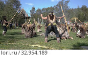 Group Itelmens people dancing ritual dance near fire and scream in traditional clothing aboriginal. Itelmens national ritual festival thanksgiving nature Alhalalalay. Kamchatka Peninsula (2019 год). Редакционное видео, видеограф А. А. Пирагис / Фотобанк Лори