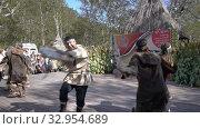 Folklore ensemble of aboriginal people of Kamchatka Peninsula dancing with tambourine in traditional clothing. Itelmens national ritual festival thanksgiving nature Alhalalalay (2019 год). Редакционное видео, видеограф А. А. Пирагис / Фотобанк Лори
