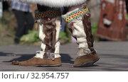 Купить «Typical national shoes of indigenous inhabitants of Kamchatka from skin of wild animal with fur out. Itelmens national ritual festival thanksgiving nature Alhalalalay. Kamchatka Peninsula», видеоролик № 32954757, снято 14 сентября 2019 г. (c) А. А. Пирагис / Фотобанк Лори