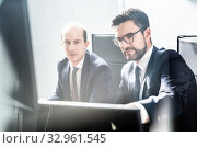Купить «Business team analyzing data at business meeting in modern corporate office.», фото № 32961545, снято 10 января 2020 г. (c) Matej Kastelic / Фотобанк Лори