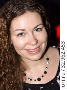 Curly woman portrait, emotional and smiling person looking at camera at party. Стоковое фото, фотограф Кекяляйнен Андрей / Фотобанк Лори