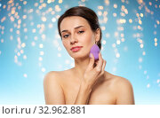 Купить «young woman with sponge applying makeup», фото № 32962881, снято 30 ноября 2019 г. (c) Syda Productions / Фотобанк Лори