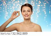 Купить «beautiful young woman with gold facial mask», фото № 32962889, снято 30 ноября 2019 г. (c) Syda Productions / Фотобанк Лори