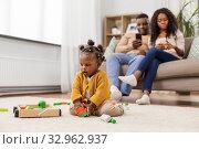 Купить «african baby girl playing with toy blocks at home», фото № 32962937, снято 29 сентября 2019 г. (c) Syda Productions / Фотобанк Лори