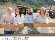 Купить «Portrait of four happy friends on a country ranch», фото № 32966321, снято 11 апреля 2019 г. (c) Яков Филимонов / Фотобанк Лори