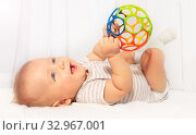 Little cute baby toddler play and hold toy ball. Стоковое фото, фотограф Сергей Новиков / Фотобанк Лори