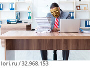Купить «Businessman wearing mask in hypocrisy concept», фото № 32968153, снято 24 июня 2019 г. (c) Elnur / Фотобанк Лори
