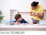 Купить «Father helping his son to prepare for school», фото № 32968241, снято 21 мая 2019 г. (c) Elnur / Фотобанк Лори