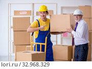 Купить «Professional movers doing home relocation», фото № 32968329, снято 1 мая 2019 г. (c) Elnur / Фотобанк Лори