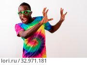 Купить «Studio shot of young scared black African man looking afraid and raising his arms against white background», фото № 32971181, снято 25 января 2020 г. (c) easy Fotostock / Фотобанк Лори
