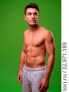 Купить «Studio shot of young handsome Hispanic man shirtless against chroma key with green background», фото № 32971189, снято 26 января 2020 г. (c) easy Fotostock / Фотобанк Лори