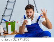Купить «Repairman doing renovation repair in the house with paper wallpa», фото № 32971805, снято 15 июля 2017 г. (c) Elnur / Фотобанк Лори