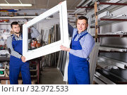 Купить «Production workers in coverall with different finished PVC profiles and windows at factory», фото № 32972533, снято 30 марта 2017 г. (c) Яков Филимонов / Фотобанк Лори