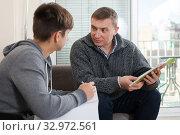 Купить «Father helps son solve school assignments», фото № 32972561, снято 8 февраля 2019 г. (c) Яков Филимонов / Фотобанк Лори