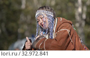 Aborigine senior women emotion dance in traditional clothing of indigenous people Kamchatka Peninsula. Itelmens national ritual festival thanksgiving nature Alhalalalay (2019 год). Редакционное видео, видеограф А. А. Пирагис / Фотобанк Лори