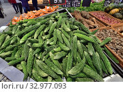 Bitter gourd and other vegetables in the supermarket. Near East. Стоковое фото, фотограф Володина Ольга / Фотобанк Лори