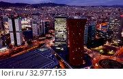 Купить «Aerial view of illuminated Plaza de Europa with modern conference center Fira Barcelona Gran Via», видеоролик № 32977153, снято 12 апреля 2019 г. (c) Яков Филимонов / Фотобанк Лори
