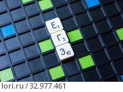 Купить «ЕГЭ. Буквы настольной игры на черном поле с цветными клетками», фото № 32977461, снято 21 июля 2019 г. (c) Papoyan Irina / Фотобанк Лори