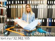 Купить «Woman holds fabric in textile store», фото № 32982105, снято 8 ноября 2019 г. (c) Tryapitsyn Sergiy / Фотобанк Лори