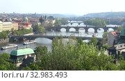 Купить «Вид на мосты Праги апрельским днем. Чехия», видеоролик № 32983493, снято 21 апреля 2018 г. (c) Виктор Карасев / Фотобанк Лори