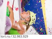 Купить «Female on climbing wall with safety belts», фото № 32983929, снято 9 июля 2018 г. (c) Яков Филимонов / Фотобанк Лори