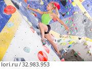 Купить «Female climbing artificial rock wall», фото № 32983953, снято 9 июля 2018 г. (c) Яков Филимонов / Фотобанк Лори