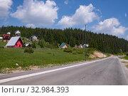 Купить «Landscape with a village and a road in the north Montenegro», фото № 32984393, снято 14 июня 2019 г. (c) Володина Ольга / Фотобанк Лори