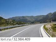 Купить «Landscape with road in the north Montenegro», фото № 32984409, снято 14 июня 2019 г. (c) Володина Ольга / Фотобанк Лори