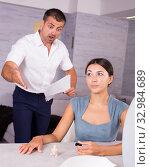 Купить «Husband scolding wife painting nails», фото № 32984689, снято 17 июля 2018 г. (c) Яков Филимонов / Фотобанк Лори