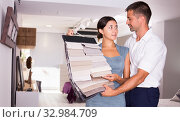 Купить «Couple choosing material for furniture in salon», фото № 32984709, снято 17 июля 2018 г. (c) Яков Филимонов / Фотобанк Лори